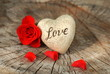 Red rose and heart on wood background