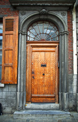 Old wooden door in the town of Mons. Belgium.