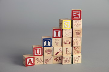 Autism spelled with play cubes