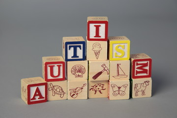 """Autism"" spelled with play blocks"