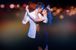 Loving couple dancing in the night city