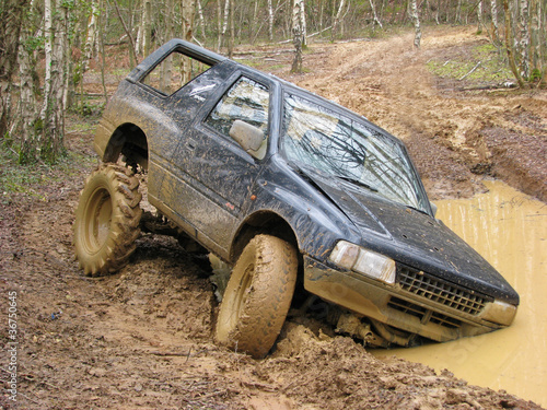 Big 4x4 off roader stuck in mud