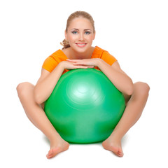 Young woman with gymnastic ball