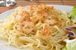 Shrimp scampi on pasta