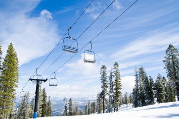 Chair lifts against the blue sky