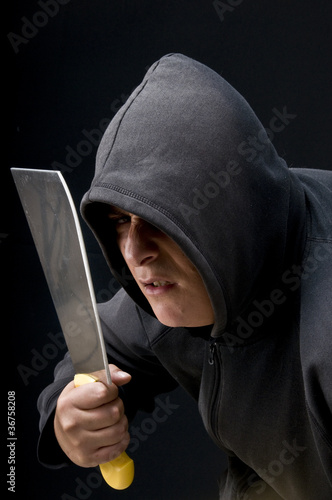 a man hold a big knife