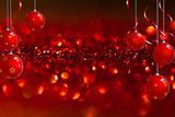 christmas baubles in front of red twinkled background poster