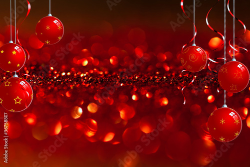 christmas baubles in front of red twinkled background