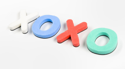 colorful letters on white background showing xoxo; love.