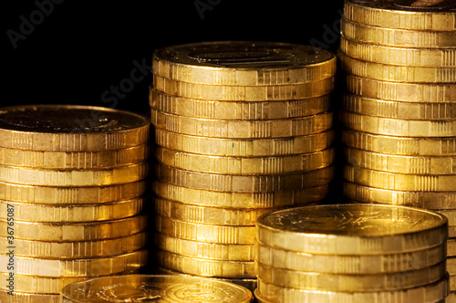 Golden coins isolated on black background