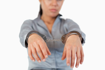 Guilty businesswoman with handcuffs