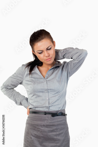 Portrait of a depressed businesswoman having back pain