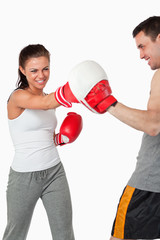 Aggressive female boxer striking her target