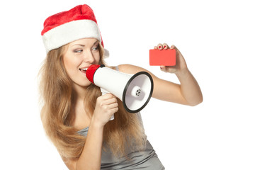 Excited female in Santa hat proclaiming into megaphone