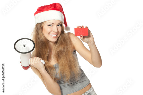 Excited female in Santa hat with megaphone