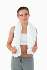 Young woman with towel around her neck