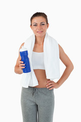 Sportswoman with bottle