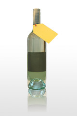 Wine bottle with a tag on a gray background