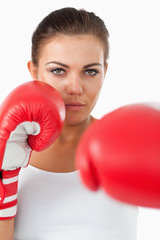 Female boxer hitting with her left