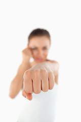 Left fist of female martial arts fighter attacking