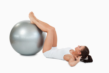 Woman developing  her abs with a ball