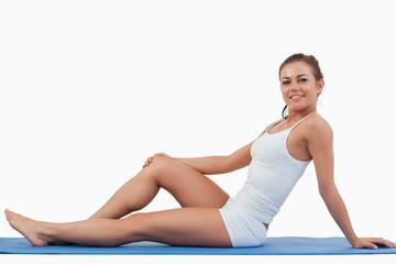Woman lying on a foam mat