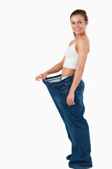 Portrait of a woman wearing too large pants