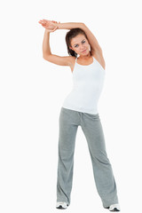 Portrait of a sports woman stretching her arms