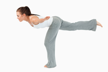 Portrait of a woman in the Virabhadrasana 3 position