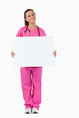 Portrait of a female doctor holding a blank panel