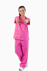 Portrait of a female doctor with thumbs up