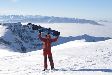 Happy man with snowboard