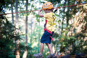 6 year old Kid climbing trees in Dolomites, Italy.
