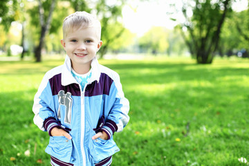 Little boy in summer park
