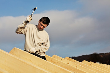 carpenters setting up a roof framework