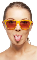 teenage girl in shades sticking out her tongue
