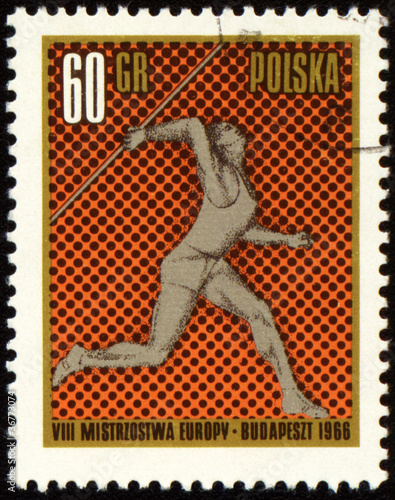 Javelin throwing on post stamp