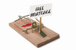 Mousetrap with free mortgage sign