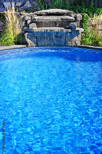 Swimming pool with waterfall - 36777416