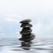 zen stones on the water