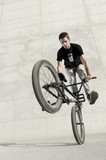 Fototapety Young BMX bicycle rider