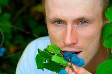 Man eats a berry