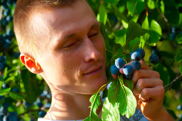 Man enjoys the smell of the fruit