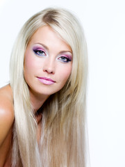 Beautiful face of blond woman with long hair