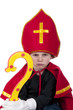 boy as Sinterklaas looking angry