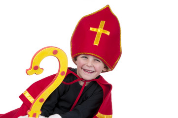 boy smiling and dressed up as Dutch Sinterklaas