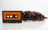 Audio cassette tape with reflection.