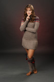 shot of a girl posing in a woolen dress