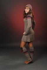 shot of a girl posing in a woolen dress