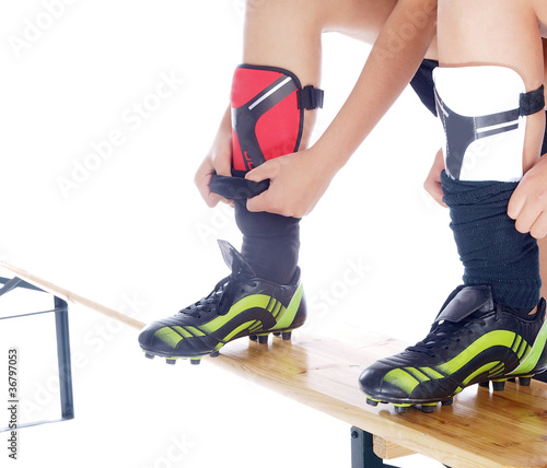 girls putting on their soccer shin guards